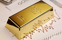 One gold bullion bar and graph