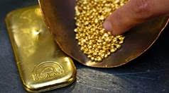 gold bar and gold nuggets